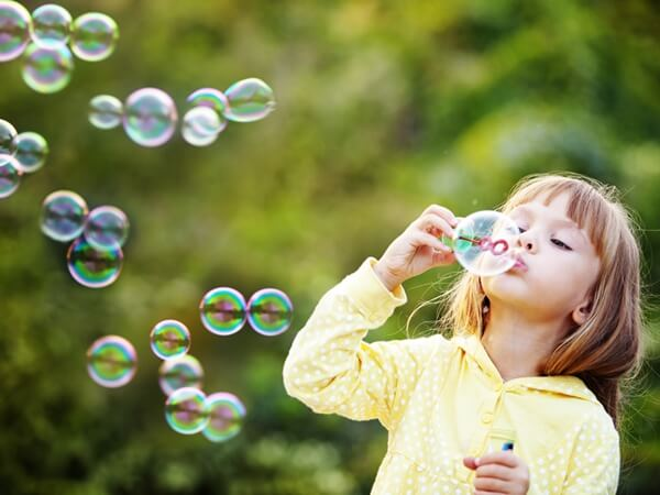 Slo-Motion in Blowing Bubbles